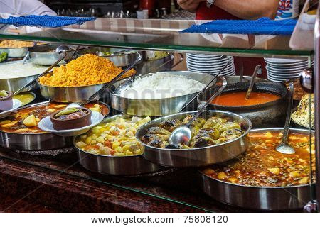 Buffet lunch in Turkish restaurant of bulgur coos coos peppers stews soup and meat dishes near Pergamum Turkey poster