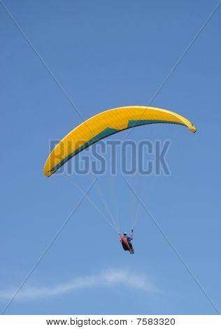 Paraglider Flying Under Beautiful Blue Sky