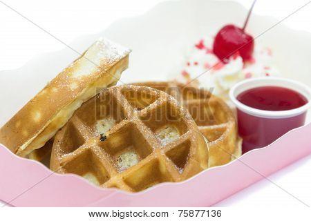 Strawberry Waffer With Powder Sugar And Cherry