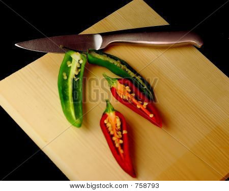 Chillies with knife and board
