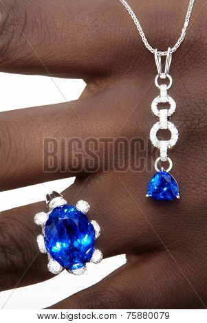 Tanzanite and Diamonds Designer Jewellery on the Hand of a Black Lady