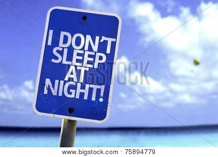 I Don't Sleep At Night sign with a beach on background