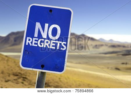 No Regrets sign with a desert background
