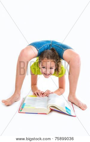 Flexible contortionist kid girl at homework with book on white background