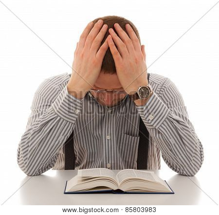 repenting praying man read Bible holding head hands