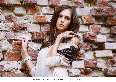 Beautiful Model Standing Near Old Brick Wall