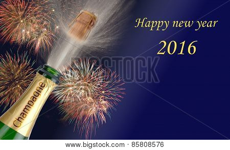 Happy new year 2016 with popping champagne