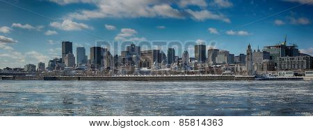 Montreal by a very cold day.  St-Lawrence river with ice with downtown Montreal in background