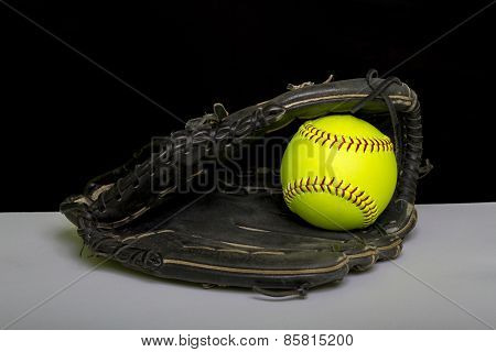 Fastpitch Softball Glove With Yellow Fastpitch Ball