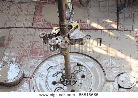 Drill pipe and rig tong on the rig floor while making up into a drillstring