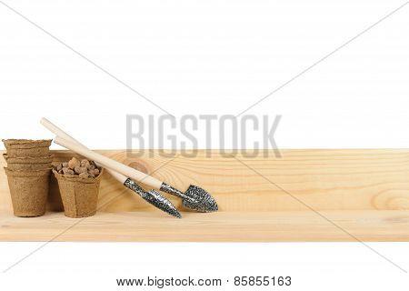 Two Small Garden Shovels Beside Peat Pots