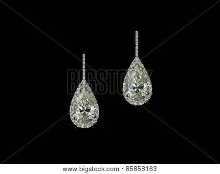 Diamond pearshapes earrings