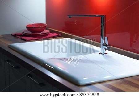 Modern Stylish Kitchen with Wooden Counter White Enamel Sink and Modern Silver Faucet Tap poster
