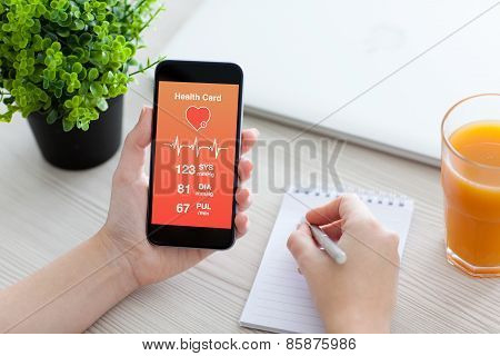 Women Hands Holding Phone With App For Health Card Monitoring