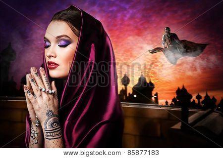 beautiful woman in oriental style with mehendi praying