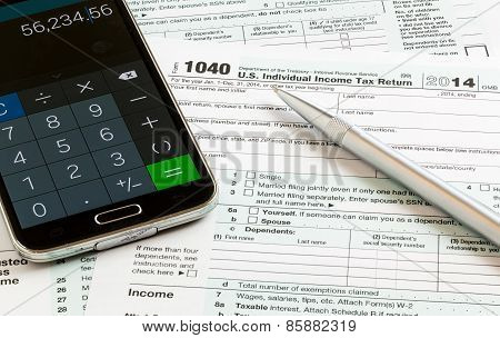 Pen And Smartphone On 2014 Form 1040