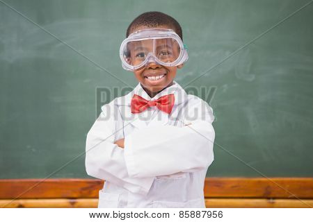 Chemistry pupil smiling at camera with arms crossed at elementary shcool