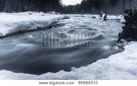 Flowing River In Winter With Snow
