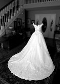 Beautiful, but empty, wedding dress. poster