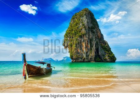 Tropical vacation holiday beach concept - Long tail boat on tropical beach, Krabi, Thailand