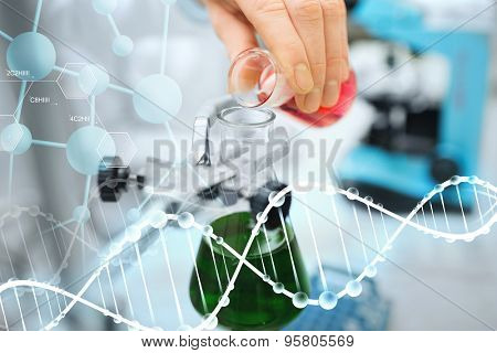 science, chemistry, biology, medicine and people concept - close up of scientist hand filling test tubes and making research in clinical laboratory  over dna molecule structure