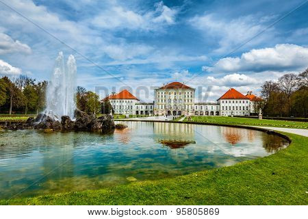 Fountain in Grand Parterre (Baroque garden) and the rear view of the Nymphenburg Palace. Munich, Bavaria, Germany