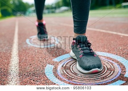 fitness, sport, training, people and healthy lifestyle concept - close up of woman feet running on track with futuristic holograms