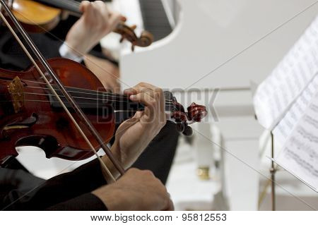 Playing On Violins And Piano