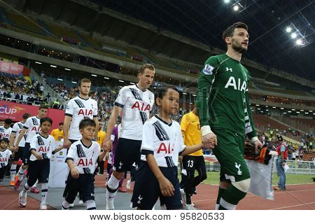 May 27, 2015 - Shah Alam, Malaysia: Tottenham Hotspur's captain Hugo Lloris (green jersey) leads his team out into the field. Tottenham Hotspur is on a Asia-Australia tour.