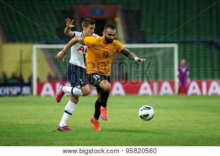 May 27, 2015- Shah Alam, Malaysia: Malaysian striker Guilmer de Paula (19) dribbles past Tottenham Hotspur's Harry Winks in a friendly match. Tottenham Hotspur is on a Asia-Australia tour.