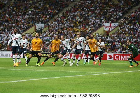 May 27, 2015 - Shah Alam, Malaysia: Malaysian strikers (orange jersey) attacks the Tottenham Hotspur (white jersey) goal in a friendly match. Tottenham Hotspur is on a Asia-Australia tour.