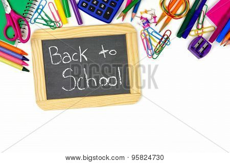 Back To School chalkboard with school supplies border