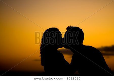 Couple In Love Kissing At Sunset