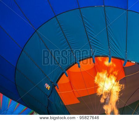 Heating up the air in hot air nylon envelope of balloon