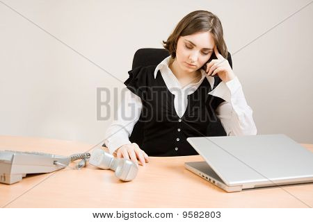 Young Secretary With  Telephone And Pencil