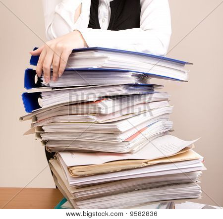 Secretary With A Lot Of Documents