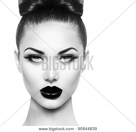 High Fashion Beauty Model Girl face close up with Black Make up and Long Lushes. Black Lips. Dark Lipstick and White Skin. Vogue Style Portrait isolated on white background