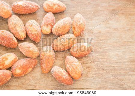 Almond Grain Roast Salt On Weathered Wooden Table