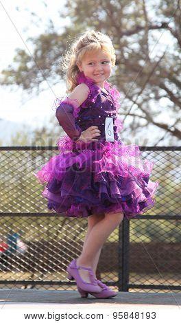 Little Blond Angel In Purple Dress At Beauty Pageant