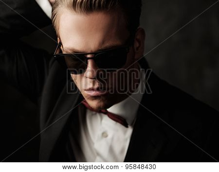 Tough sharp dressed man in black suit  poster