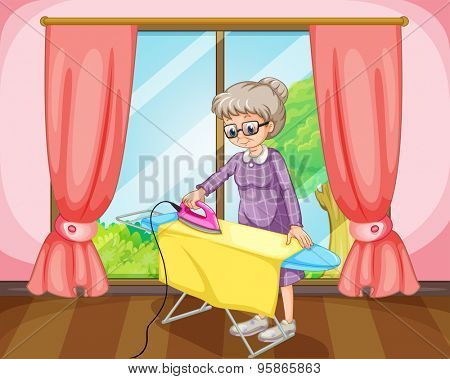 Old female standing and ironing yellow cloth in a room