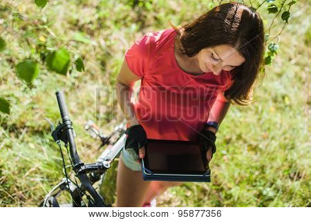 Sport Girl On Bicycle Hold Digital Tablet