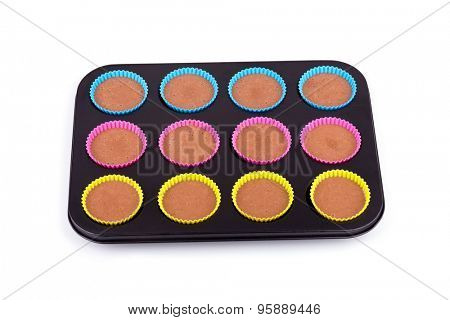 Preparation of chocolate muffins, isolated on white