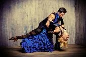 Two beautiful dancers perform the tango. Latin American dances.  poster