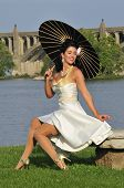 glamor portrait of a beautiful sultry pinup girl with a black parasol poster