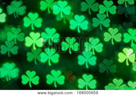 St Patricks Day green shamrock bokeh background -St Patricks Day postcard. Symbol of St Patricks Day. St Patricks Day bokeh background. St Patricks Day card