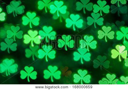 St Patricks Day green shamrock bokeh background -St Patricks Day postcard. Symbol of St Patricks Day. St Patricks Day bokeh background. St Patricks Day card