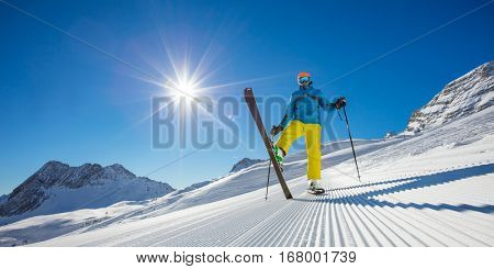 Skier on piste in sunny day. Skiing concept. Alpine ski resort in Zugspitze, Germany.