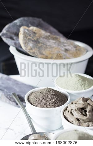 Ancient minerals - luxury face and body spa treatment clay powder and mask green blue and black clay poster