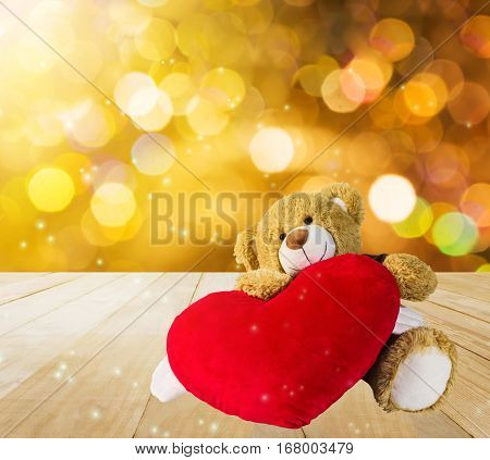 Cute Bear Doll Sit With Red Heart In Dreamy Gold Bokeh Light Background